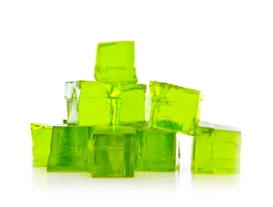 Cubes of Lime jello on a white background