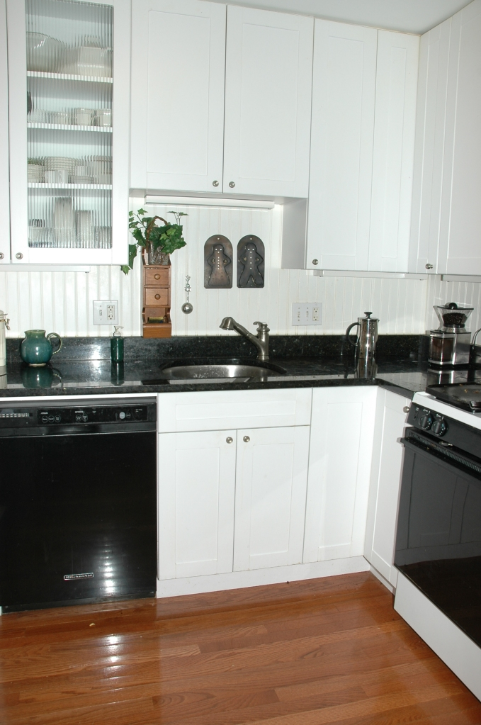 Full disclosure: I don't exactly hate the current look. This was my last kitchen, which I designed.